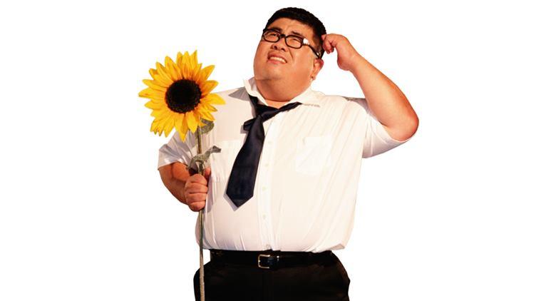 Businessman holding sunflower